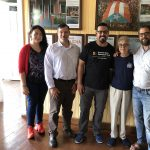 Photo of Dr. Arturo Massol Deya with his mother and three members of Team GPII