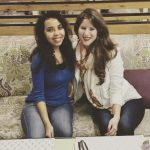 Image of Caitlin Rusche, right, with friend Shaimaa, left