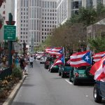 Image of cars with Puerto Rican flags driving down Orange Avenue