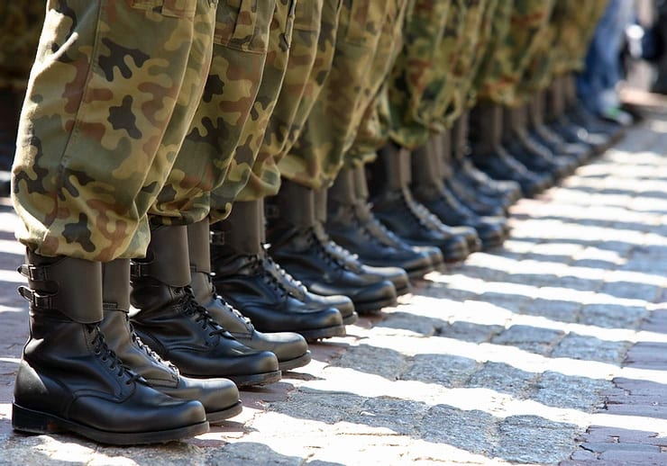 Military personnel lined up_